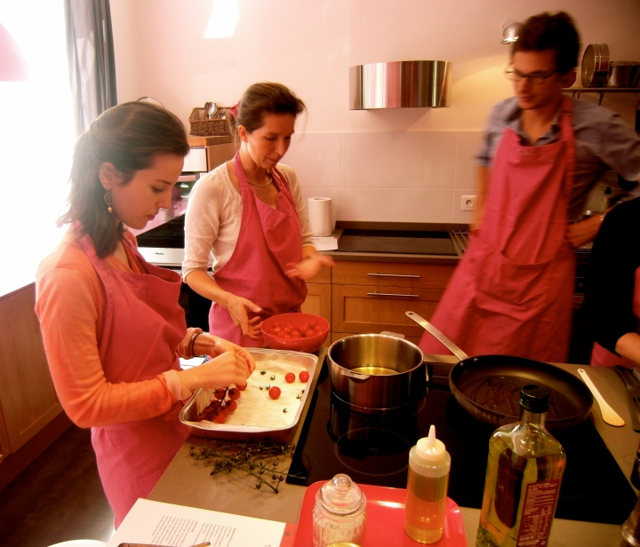 Witness: A homme in the pink kitchen. Learning to cook exquisite meals alongside his chic Parisian wife, no less.
