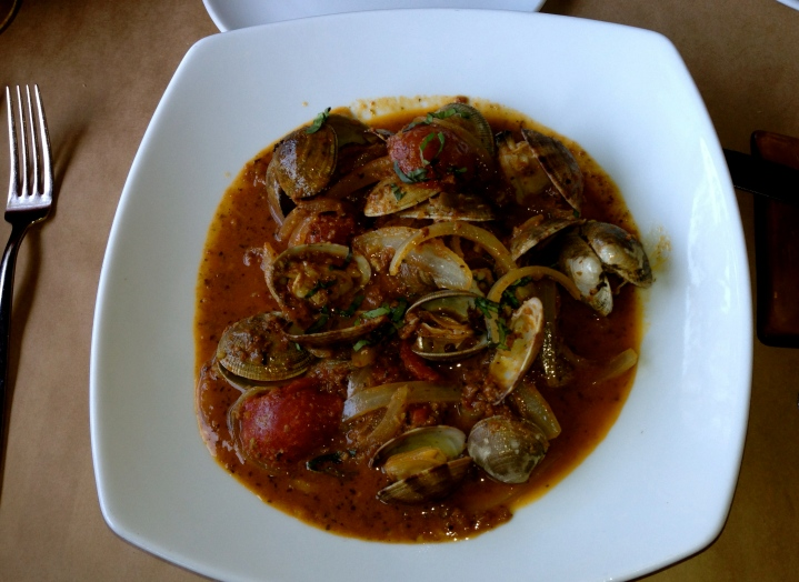 Portuguese clams at River's End. Manila clams steamed in white wine with house made chorizo, sauteed garlic, tomatoes, and the house herb butter