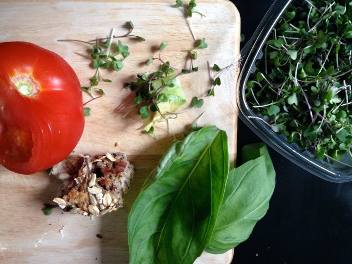 Organic basil and microgreens from Two Guys from Woodbridge make a fantastic snack with celery, avocado, tomato, and Breads Bakery's Swiss Muesli Roll