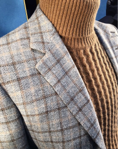 Larusmiani handmade cashmere wool jacket with hand stitched suede details over a cashmere sweater.